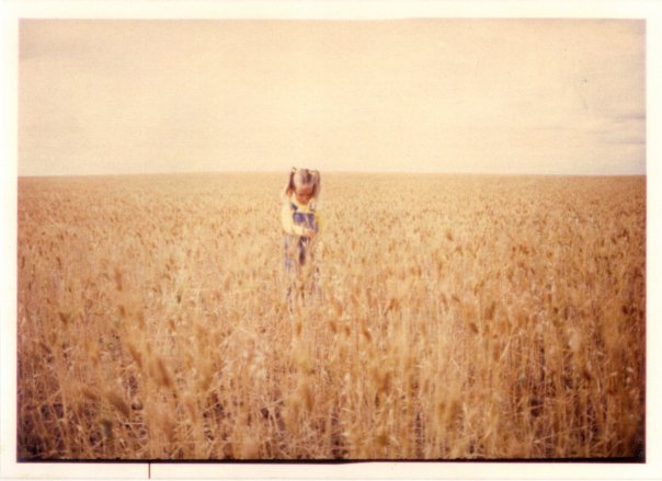 Me as a young child standing in a wheat field in Saskatchewan